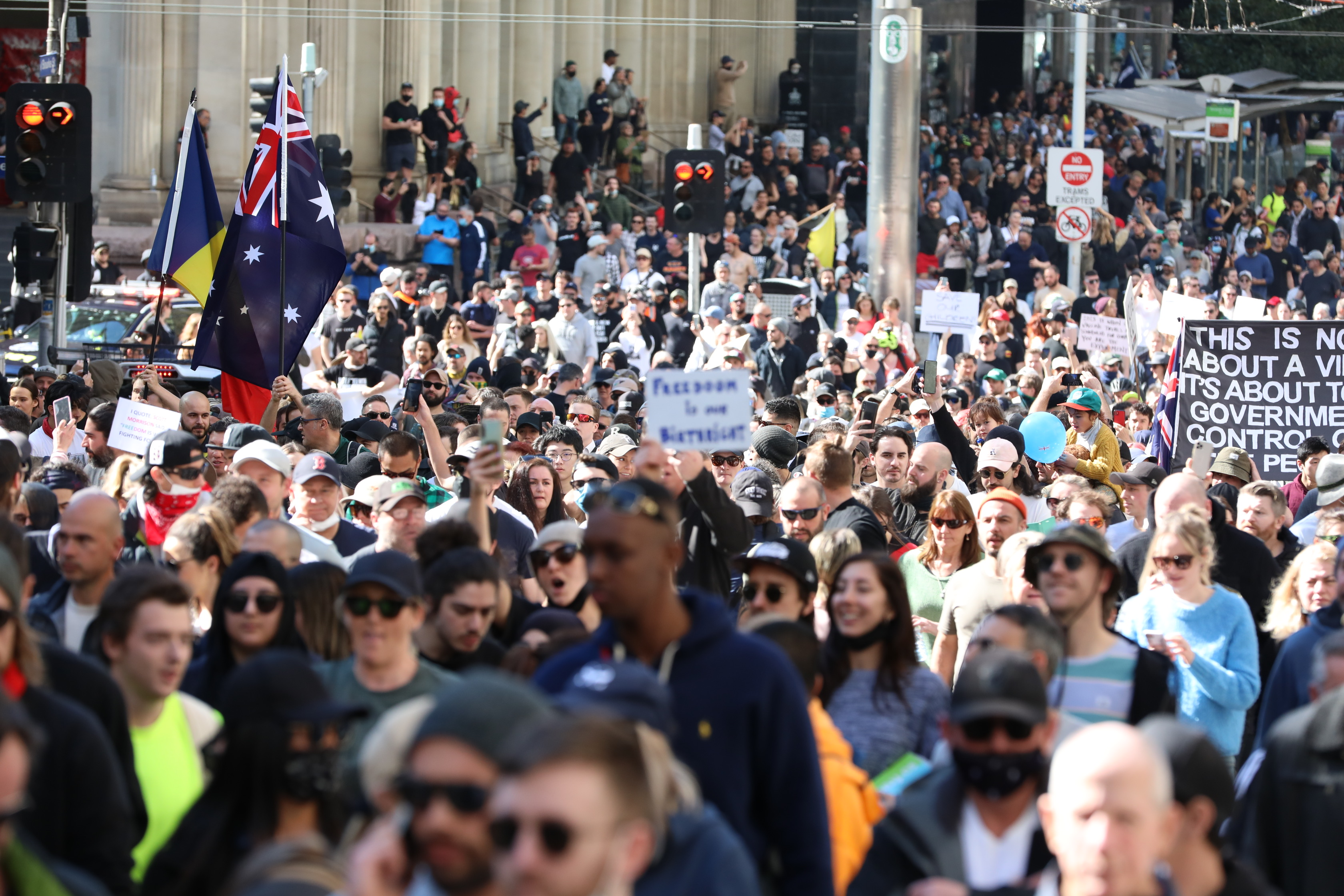 Thousands of people gather in Melbourne's CBD to protect lockdown restrictions on August 21, 2021 in Melbourne, Australia. Anti-lockdown protesters gathered despite current COVID-19 restrictions prohibiting outdoor gatherings. Lockdown restrictions are currently in place across Melbourne as Victoria continues to record new cases of the highly infectious COVID-19 Delta variant. A curfew is also now in place from 9 pm to 5 am each night across the metropolitan area. The restrictions are set to remain in place until 11.59 pm on Thursday, 2 September.