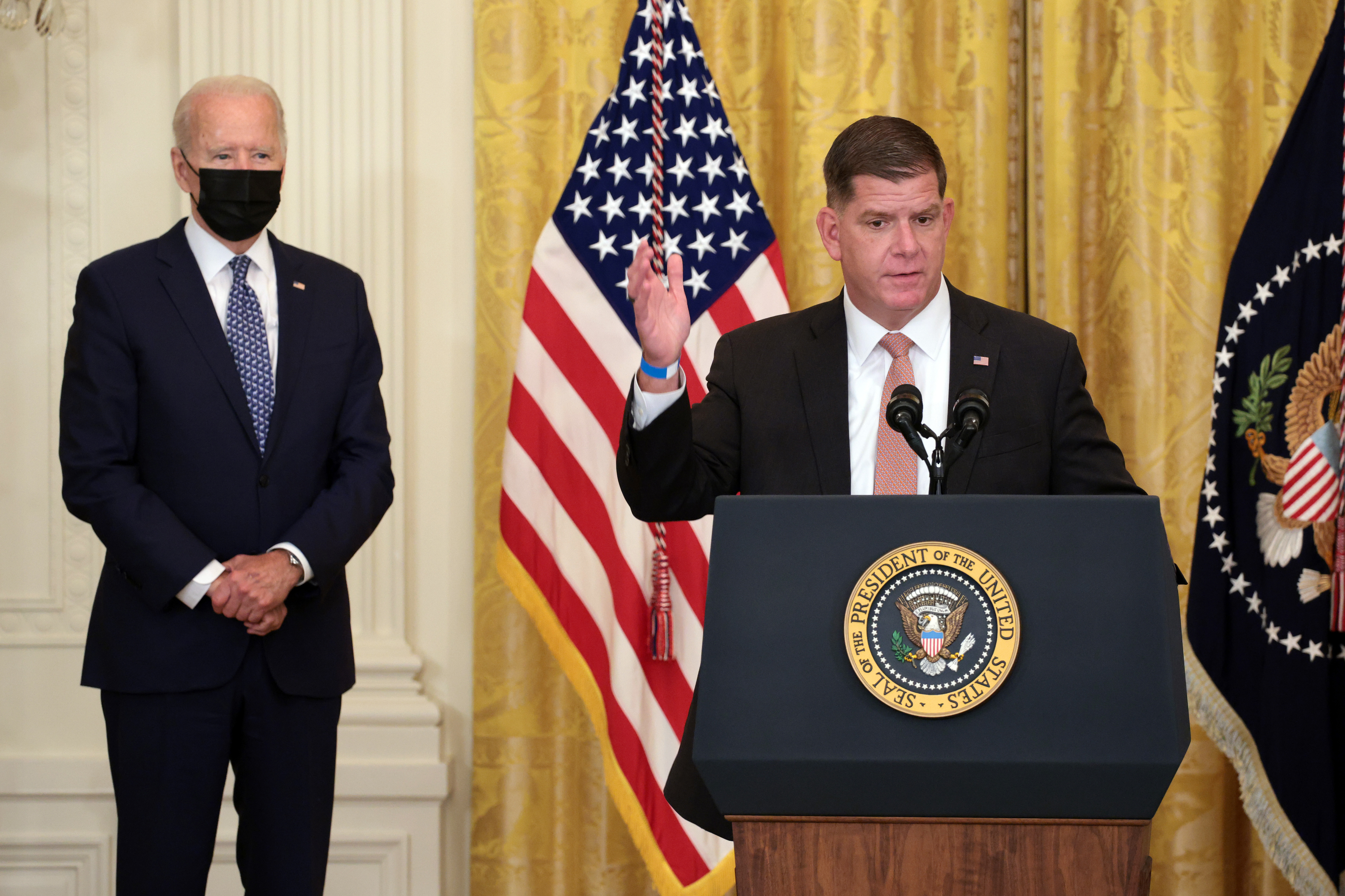Labor Secretary Marty Walsh speaks alongside Joe Biden during an event on workers rights and labor unions in the East Room at the White House in Washington, DC. (Photo by Kevin Dietsch/Getty Images)