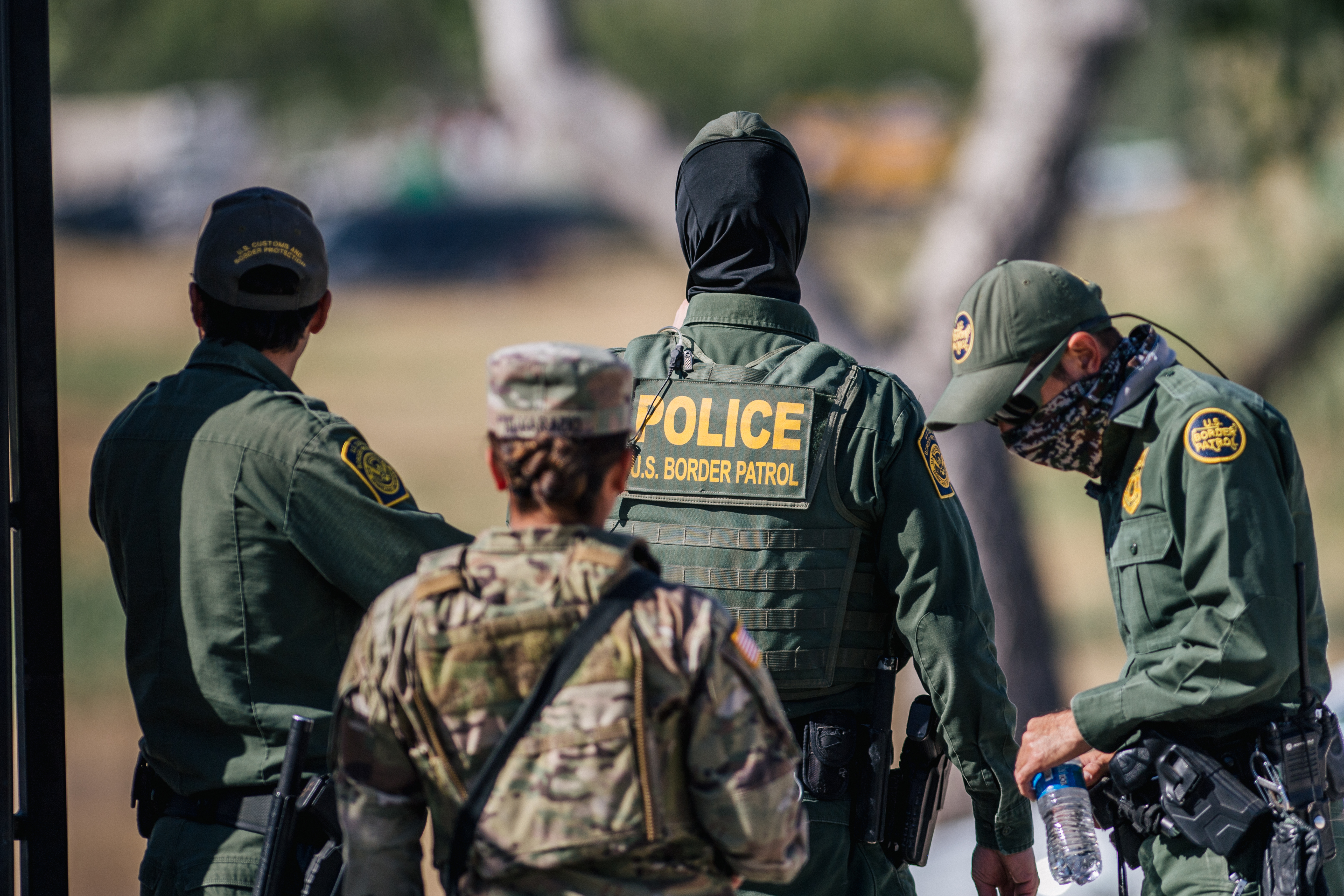Border Patrol agents and members of the National Guard patrol a checkpoint entry near the Del Rio International Bridge in Del Rio, Texas. Thousands of immigrants, mostly from Haiti, seeking asylum have crossed the Rio Grande into the United States. (Photo by Brandon Bell/Getty Images)