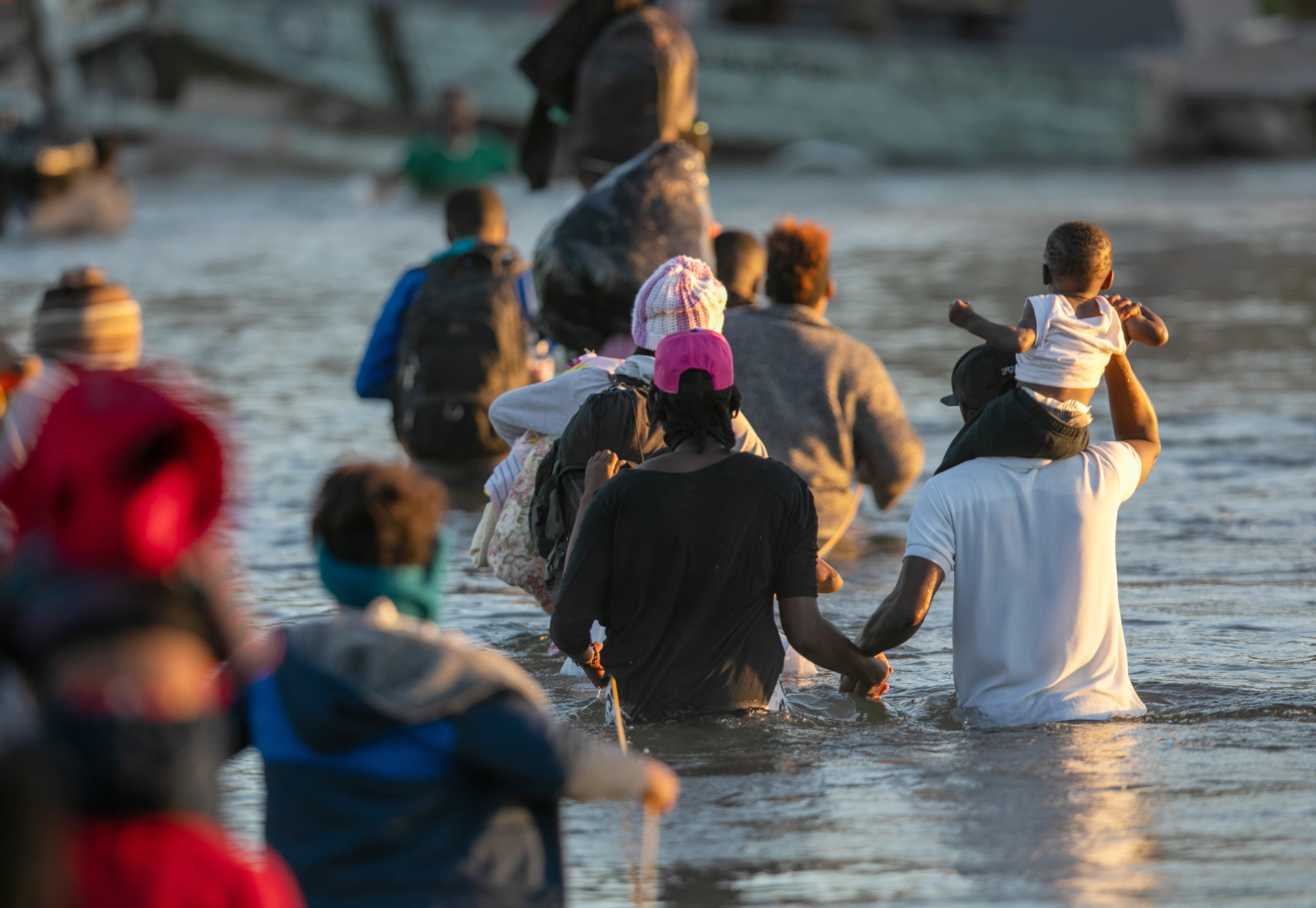 Haitian immigrant families cross the Rio Grande into Del Rio, Texas from Ciudad Acuna, Mexico. (Photo by John Moore/Getty Images)
