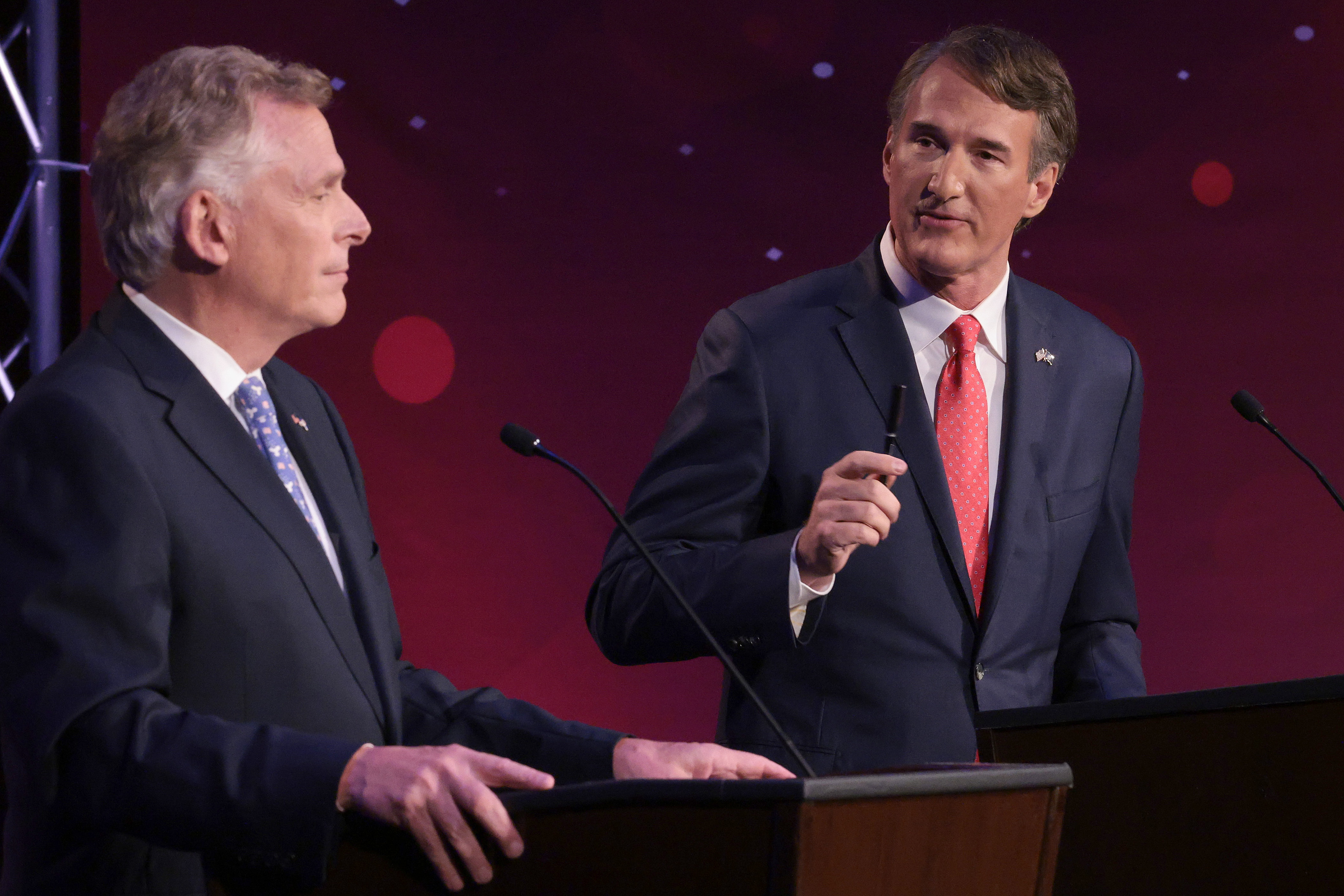 Former Virginia Gov. Terry McAuliffe (left) (D-Va.) and Republican gubernatorial candidate Glenn Youngkin (right) particpate in a debate hosted by the Northern Virginia Chamber of Commerce in Alexandria, Virginia. The gubernatorial election is November 2. (Photo by Win McNamee/Getty Images)