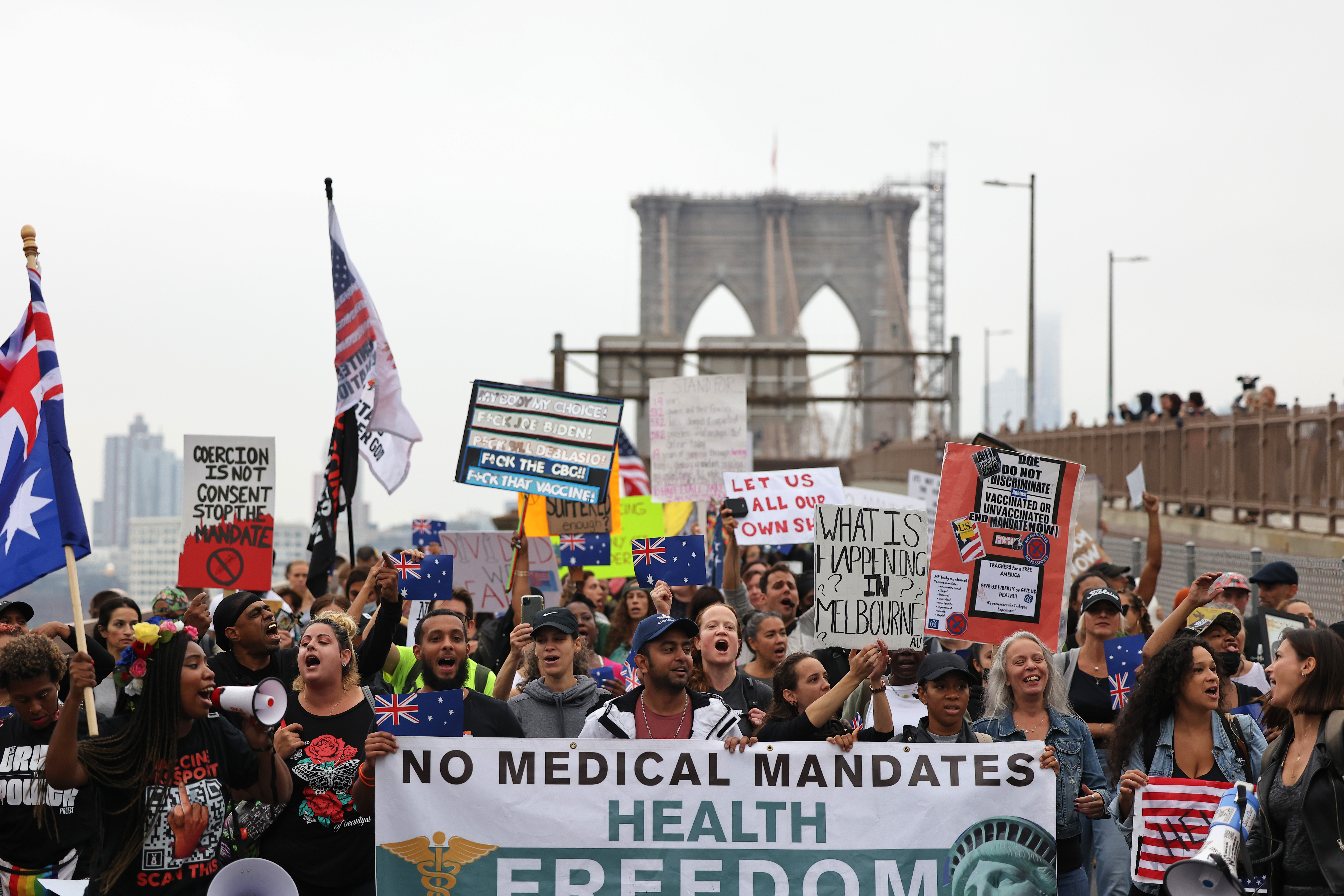 People march as they protest against NYC's COVID-19 vaccine mandate that went into effect today for public school employees on October 04, 2021 in New York City. (Photo by Michael M. Santiago/Getty Images