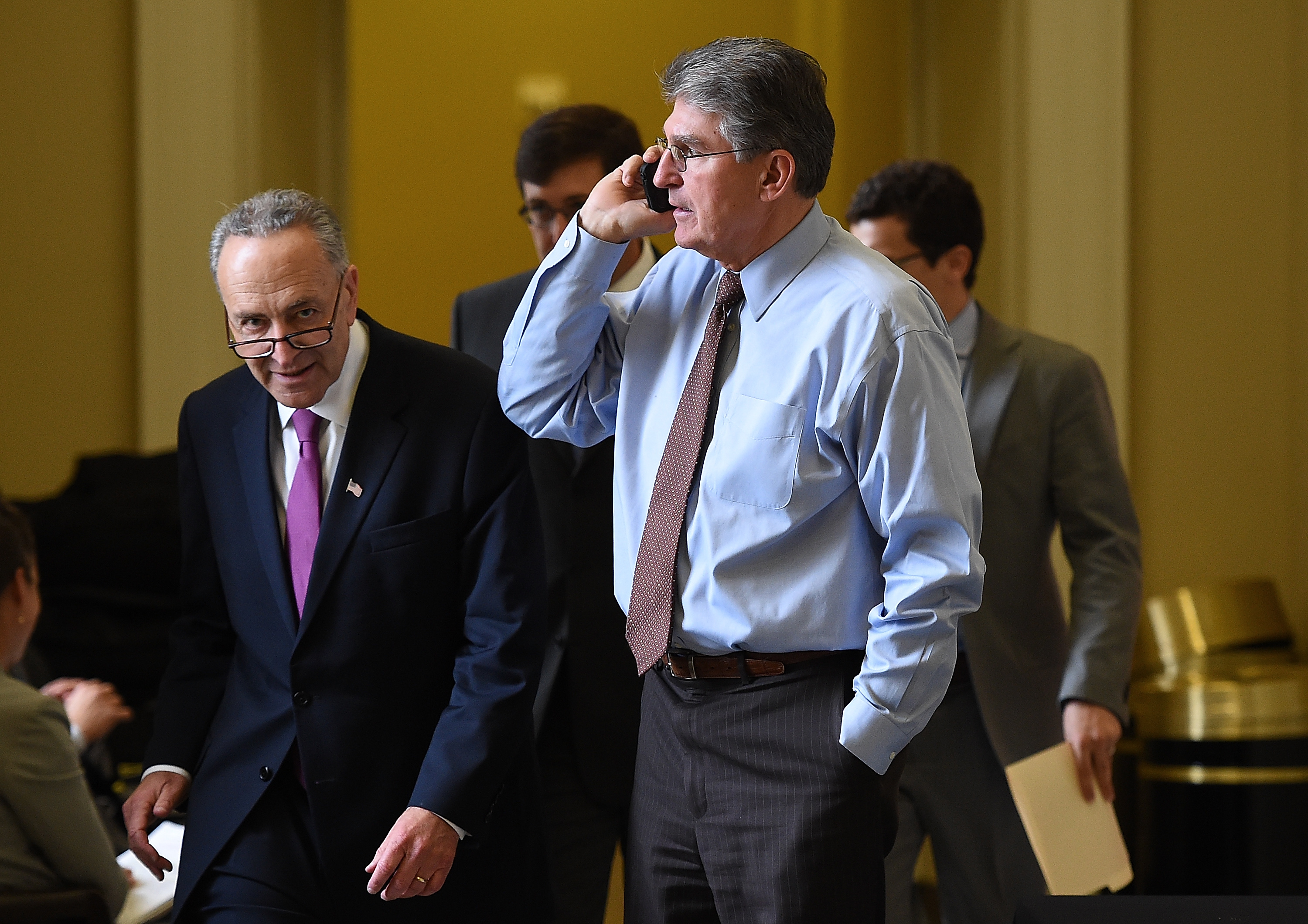 Sen. Charles Schumer (D-N.Y.) (left) passes Sen. Joe Manchin (D-W.Va.) (right) at the U.S. Capitol in Washington, DC. (Photo by Win McNamee/Getty Images)