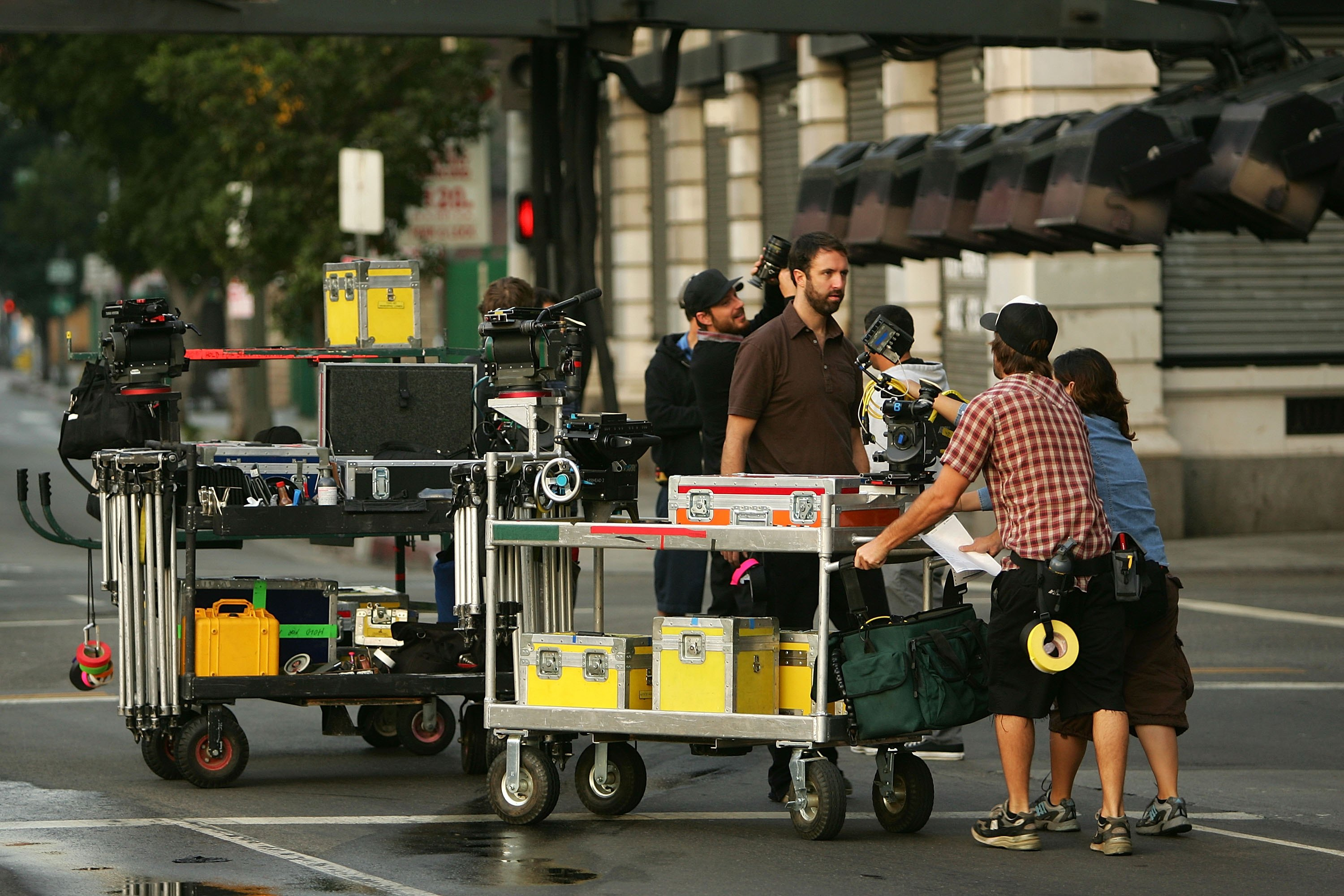A crew sets up cameras for the filming a mobile phone commercial on-location in Los Angeles, California. (Photo by David McNew/Getty Images)