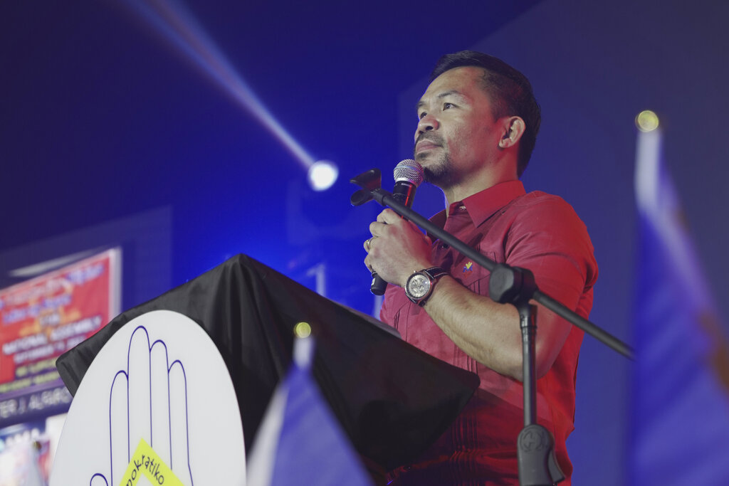 In this photo provided by the Manny Pacquiao MediaComms, Senator Manny Pacquiao speaks during a national convention of his PDP-Laban party in Quezon city, Philippines on Sunday Sept. 19, 2021. Philippine boxing icon and senator Manny Pacquiao says he will run for president in the 2022 elections. (Manny Pacquiao MediaComms via AP)