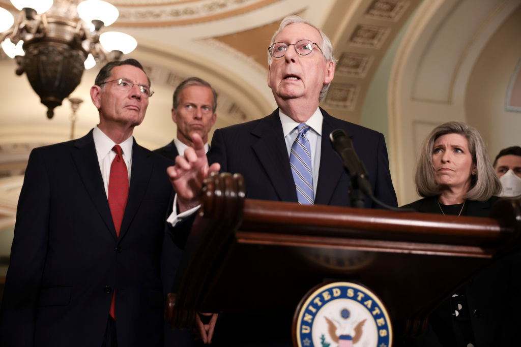 WASHINGTON, DC - OCTOBER 05: Senate Minority Leader Mitch McConnell (R-KY) addresses reporters following a weekly Republican policy luncheon as (L-R) Sen. Rick Scott (R-FL), Sen. John Barrasso (R-WY), Sen. John Thune (R-SD), and Sen. Joni Ernst (R-IA) look on in the U.S. Capitol on October 05, 2021 in Washington, DC. During their news conference McConnell reiterated his belief that the Senate should pass legislation to raise the federal debt-limit through reconciliation. (Photo by Anna Moneymaker/Getty Images)
