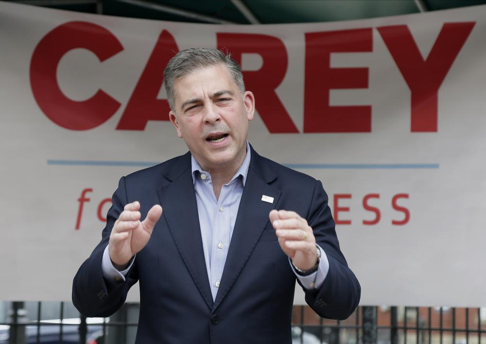 In this June 1, 2021 photo, Mike Carey, speaks at the kick-off of his 15th Congressional District campaign in Grove City, Ohio. Former President Donald Trump has backed Carey, a longtime coal lobbyist, as one of the candidates in the crowded Republican primary for an open U.S. House seat in central Ohio. (Barbara J. Perenic/Columbus Dispatch via AP, File)