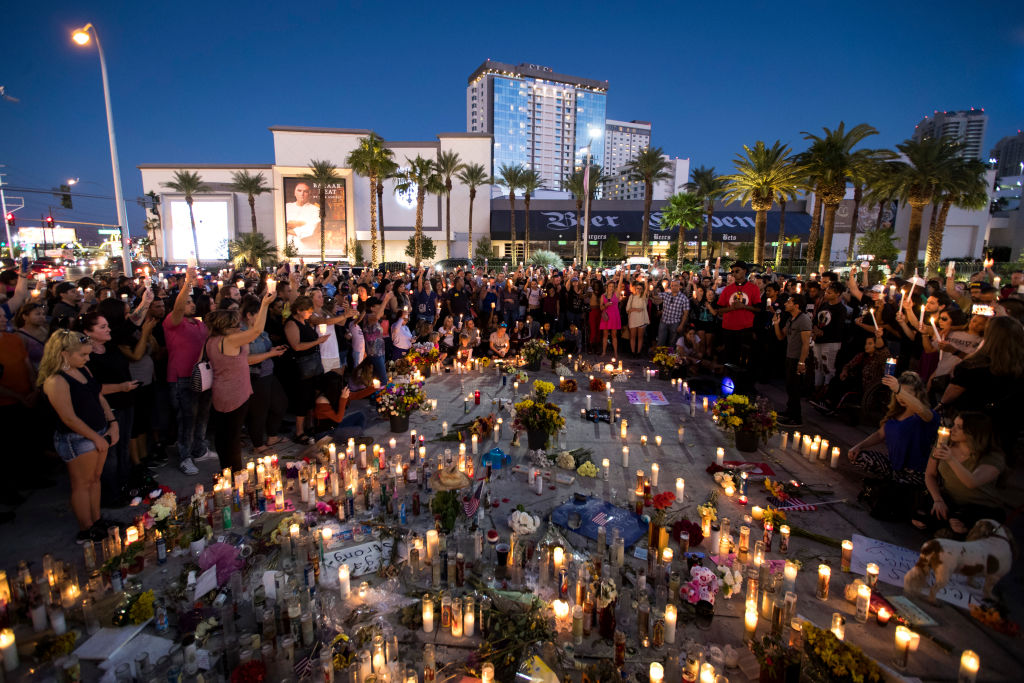 LAS VEGAS, NV - OCTOBER 8: Mourners hold their candles in the air during a moment of silence during a vigil to mark one week since the mass shooting at the Route 91 Harvest country music festival, on the corner of Sahara Avenue and Las Vegas Boulevard at the north end of the Las Vegas Strip, on October 8, 2017 in Las Vegas, Nevada. On October 1, Stephen Paddock killed 58 people and injured more than 450 after he opened fire on a large crowd at the Route 91 Harvest country music festival. The massacre is one of the deadliest mass shooting events in U.S. history. (Photo by Drew Angerer/Getty Images)