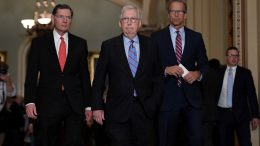 (L to R) Senator John Barrasso (R-WY), Senate Minority Leader Mitch McConnell (R-KY) and Senator John Thune (R-SD) arrive to talk to reporters following the Senate Republican policy luncheon at the US Capitol on October 19, 2021 in Washington, DC. (Photo by Olivier DOULIERY / AFP) (Photo by OLIVIER DOULIERY/AFP via Getty Images)