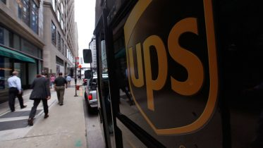 CHICAGO - JULY 23: A United Parcel Service Inc. (UPS) truck makes deliveries July 23, 2009 in Chicago, Illinois. UPS today reported second-quarter income fell 49 percent on continued weak demand. (Photo by Scott Olson/Getty Images)
