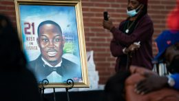 WAYNESBORO, GA - FEBRUARY 23: A painting of Ahmaud Arbery is displayed during a vigil at New Springfield Baptist Church on February 23, 2021 in Waynesboro, Georgia. Arbery, a Black man, was shot and killed while jogging near Brunswick, Georgia a year ago today after being chased by two white men. (Photo by Sean Rayford/Getty Images)