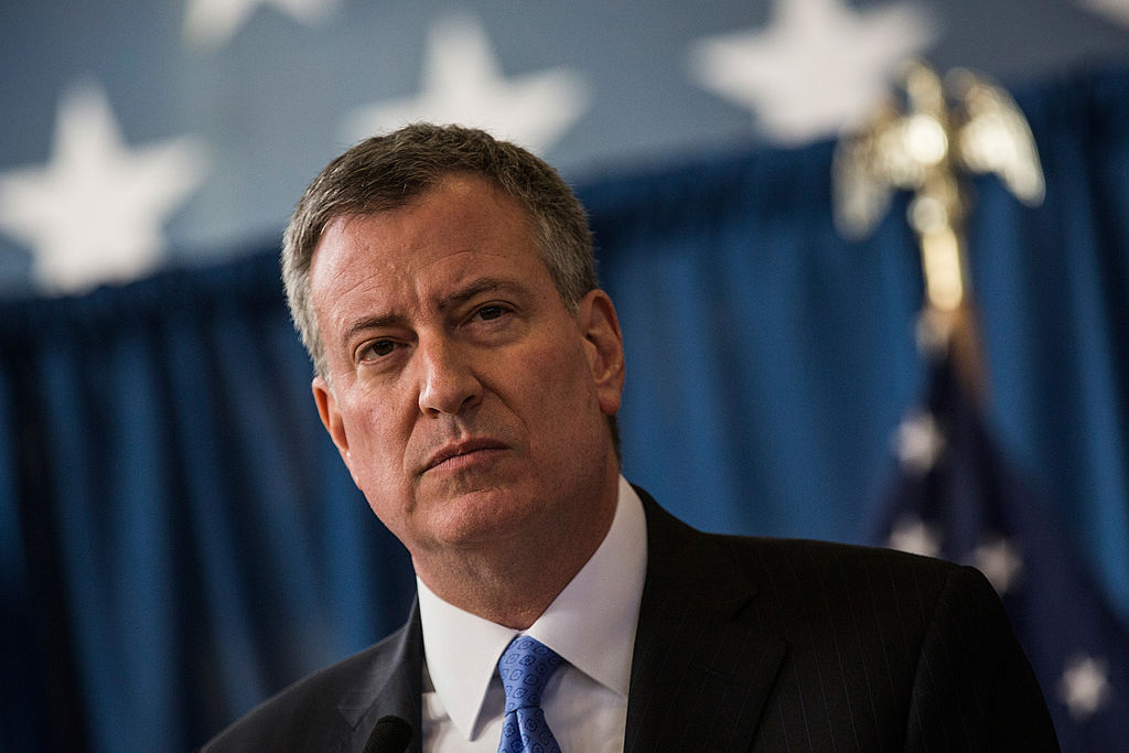 """NEW YORK, NY - JANUARY 30: New York City Mayor Bill de Blasio speaks at a press conference to announce the city will not appeal a judge's ruling that the police tactic """"Stop-and-Frisk"""" is unconstitutional, which the judge had ruled over last summer, on January 30, 2014 in in the Brownsville neighborhood of the Brooklyn borough ofNew York City. DeBlasio, who campaigned for mayor saying he would stop """"stop-and-frisk,"""" stands in stark contrast to his predecessor, Mayor Michael Bloomberg, who staunchly defended the tactic. (Photo by Andrew Burton/Getty Images)"""