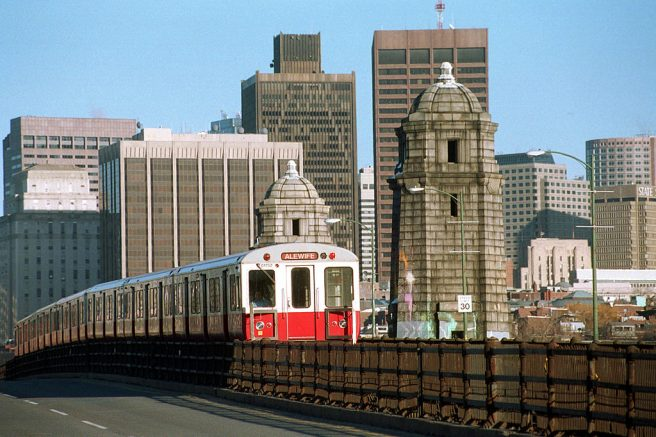 386595 01: A Red Line subway car, known as the T in Boston, crosses the Charles River March 12, 2001 in Cambridge, MA. Boston's subway system, the oldest in the nation, has plans to auction off the rights to name four of its busiest stations. Last week's pre-bid meeting brought no potential bidders. (Photo by Darren McCollester/Newsmakers)