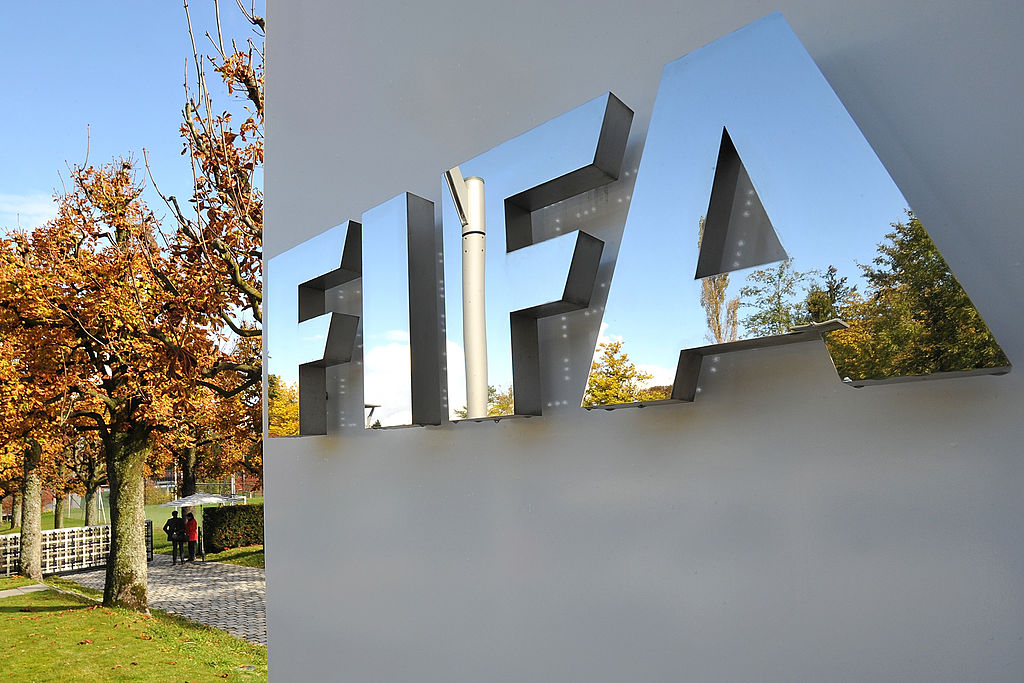 ZURICH, SWITZERLAND - OCTOBER 20: The FIFA logo is seen outside the FIFA headquarters prior to the FIFA Executive Committee Meeting on October 20, 2011 in Zurich, Switzerland. During their third meeting of the year, held over two days, the FIFA Executive Committee will approve the match schedules for the FIFA Confederations Cup Brazil 2013 and the 2014 FIFA World Cup Brazil. (Photo by Harold Cunningham/Getty Images)