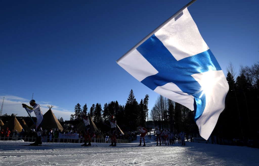 LAHTI, FINLAND - FEBRUARY 25: A Finland flag is waved as the skiers compete in the Men's Cross Country Skiathlon during the FIS Nordic World Ski Championships on February 25, 2017 in Lahti, Finland. (Photo by Matthias Hangst/Getty Images)