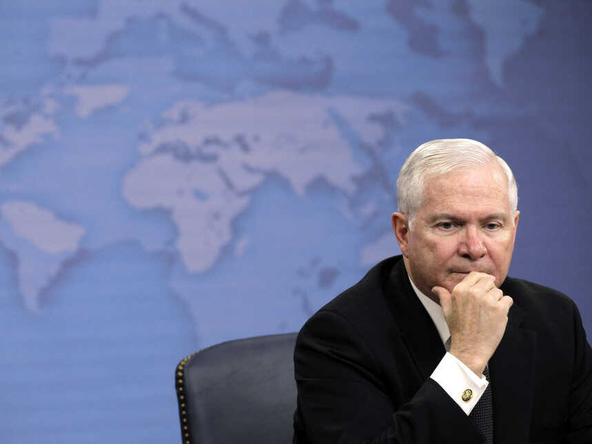 FILE - Former Defense Secretary Robert Gates listens to a reporter's question during a news briefing about gays in the military Tuesday at the Pentagon. Charles Dharapak/AP Photo)
