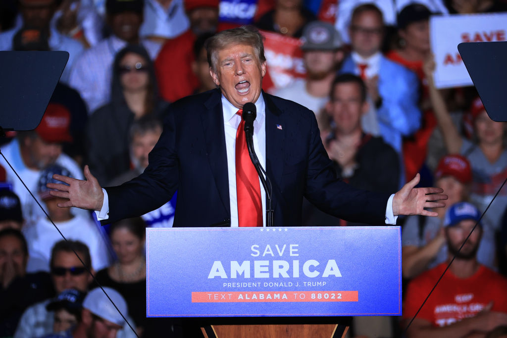 """CULLMAN, ALABAMA - AUGUST 21: Former U.S. President Donald Trump addresses supporters during a """"Save America"""" rally at York Family Farms on August 21, 2021 in Cullman, Alabama. With the number of coronavirus cases rising rapidly and no more ICU beds available in Alabama, the host city of Cullman declared a COVID-19-related state of emergency two days before the Trump rally. According to the Alabama Department of Public Health, 67.5% of the state's population has not been fully vaccinated. (Photo by Chip Somodevilla/Getty Images)"""