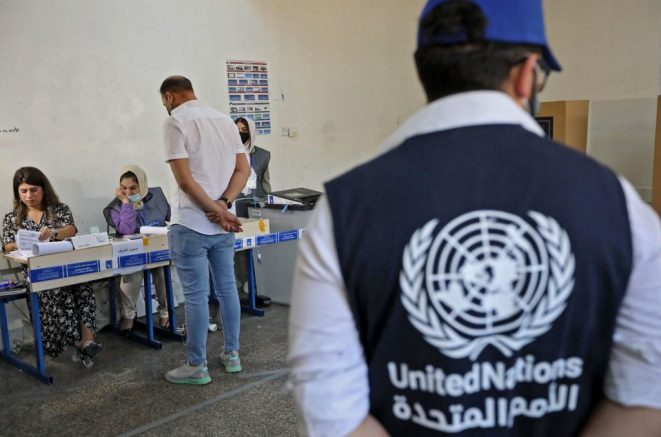 A displaced Iraqi casts his ballot in the presence of UN observers at a polling station in Arbil, the capital of the northern Iraqi Kurdish autonomous region, on October 8, 2021, two days before the rest of the country in a poll overshadowed by expectations for a low turnout. - War-scarred Iraq will hold parliamentary elections on October 10, a year ahead of schedule to appease an anti-government protest movement, and amid a painful economic crisis. (Photo by SAFIN HAMED / AFP) (Photo by SAFIN HAMED/AFP via Getty Images)