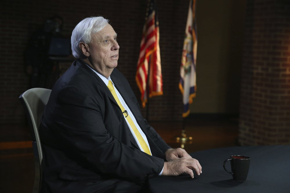 West Virginia Gov. Jim Justice prepares for a debate with Democratic challenger Ben Salango, the Kanawha County Commissioner, in Morgantown, W.Va., Tuesday Oct. 13. 2020. (AP Photo/Kathy Batten)
