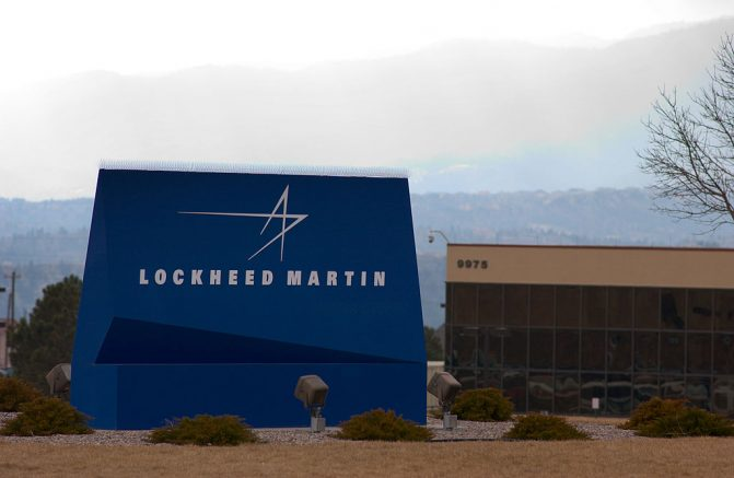 COLORADO SPRINGS, C0 - DECEMBER 4: A sign for Lockheed Martin is seen December 4, 2003 in Colorado Springs, Colorado. Officials from Lockheed Martin demonstrated their new Total Integrated Warfare Capstone Project, a system to better integrate the communications and logistics of the battlefield. The goal of the system is to better coordinate complex operations to deal with constantly changing battle situations. (Photo by Kevin Moloney/Getty Images)