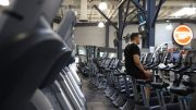 SAN FRANCISCO, CALIFORNIA - OCTOBER 15: A Fitness SF customer rides a stationary bike without a face mask a Fitness SF gym on October 15, 2021 in San Francisco, California. The City and County of San Francisco has started to ease indoor mask mandates today that allows groups of up to 100 vaccinated people to go without masks at gyms, religious gatherings, college classes and offices. (Photo by Justin Sullivan/Getty Images)